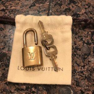 Louis Vuitton Accessories - Authentic Louis Vuitton Lock, 2 keys and pouch